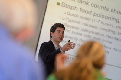 Dennis D'Amico, assistant professor of animal science, speaks about cheesmaking and food safety at the W. B. Young Building on June 6, 2014. (Peter Morenus/UConn Photo)
