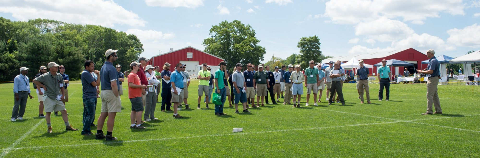 turfgrass field day participants listen to Dr. Jason Henderson