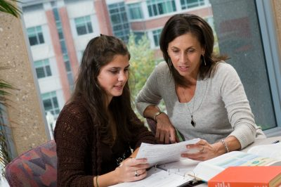 Nancy Rodriguez advising a student in UConn Nutritional Sciences