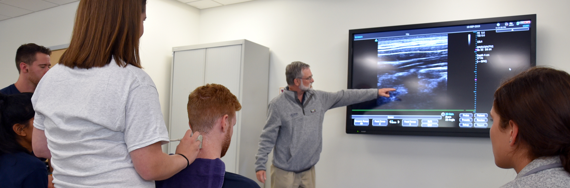 looking at an ultrasound at UConn CAHNR campus