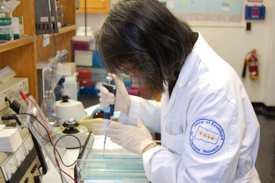 woman in lab coat working in laboratory