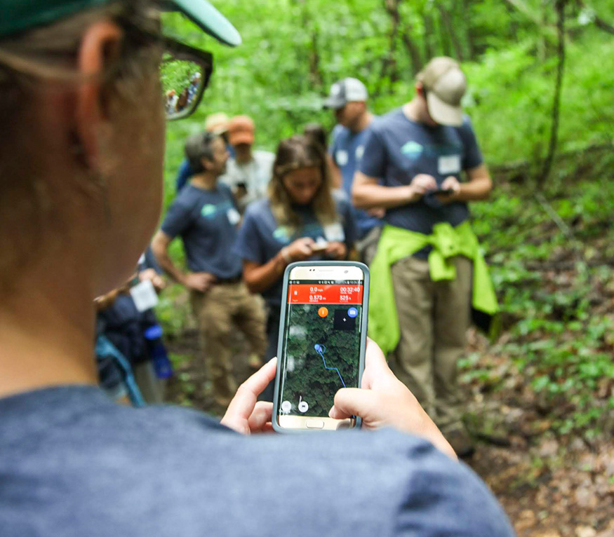 GPS training with students in the woods